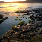 Beach area close to bottom of stairs, sunset, low tide...stunning