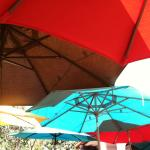 lovely canopy of colorful umbrellas keeps the patio shady during the day