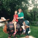 Riding the bull outside the lounge at the Baymont Inn and Suites