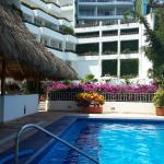 Large pool surrounded by bougainvillea