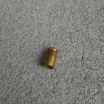 Pistol shell outside our room