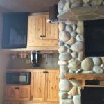 Rock fireplace and wet bar