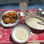 Good variety of snacks available for lunch, here pakora with the best raita ever, served by the