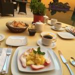 Breakfast with fruits and huervos rancheros