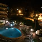 night time view of pool area, oudoor dining and restaurant area