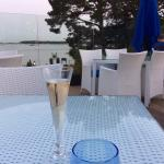 A glass of bubbles on the deck
