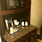 microvave and coffee maker in the room