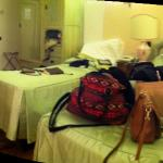 A poorly done panorama of the room. Comfortably housed three weary college kids.