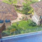 View of the pool and cabana from the master bedroom in seafront bungalow