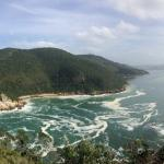 View over the ocean and the cliffs who made entering into the Knysna harbour so difficult