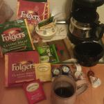 Folgers, ceramic coffee mugs, and assorted teas in room