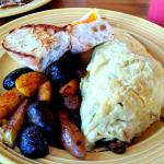 Croissant French Toast and Omelet with potatoes and rustic bread