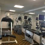 Fitness Room. 2 bikes, a treadmill & an elliptical. No weights, but towels + water. Looks at poo