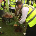 hotel staff tree planting in their garden
