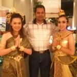 Hotels staff in traditional attire welcoming guests.