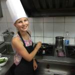 my daughter during the cooking class in the hotel restaurant
