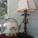 Adorable watering pot and lamp on 2nd floor porch!