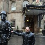 My friend with the famous statue in front of the hotel's entrance