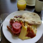 scramble eggs, baked tomato, beef sausage serve with cheese, falafel  bread, babah gahnous