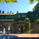 View from the pool to the villa
