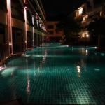 Pool at night - pool access rooms on left