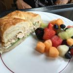 Chicken salad on croissant with fresh fruit