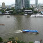 River taxi heads upsteam in front of the Shangri La