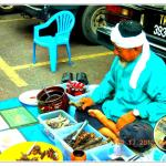 Malay man selling local medicine