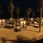 The private cabanas at night.