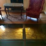 Parlor in Governor Calvert House with the glass floors to see the original foundation.