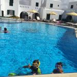 My kids swimming in the pool.