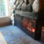 Cozy fireplace in cabin 16