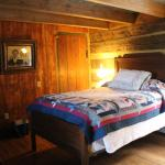 Antique bed in vintage log cabin