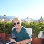 having a glass of vino rosso on the terrace