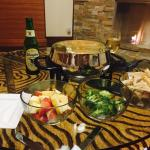 Fondue for 2 in our room! Couches so comfy my toddler fell asleep on it!
