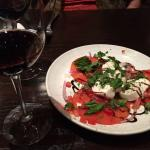 Caprese salad and wine.