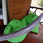Beanbags and hammock to enjoy the view from the verandah in our bungalow