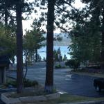 View of the lake in the morning looking past trees and conference center to the left.