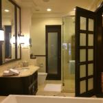 large bathroom  with a large tub and shower stall