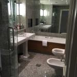 spacious bathroom with tub and stand shower