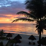 Beautiful sunrise from our beachfront deck in the Cielo room