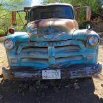 The bed of this truck was used to display birdhouses and other items for sale.