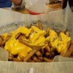 Mound of delicious cheese fries.