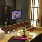 Bathroom with makeup mirror, stool, and built in mirror TV...a girls dream!!!