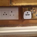 A vast array of electrical outlets and even a removable adapter