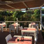 The terrace seating area, great for breakfast or dinner, surrounded by a beautiful garden.