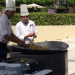 Cooking paella poolside