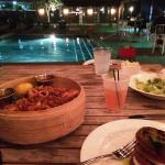 Poolside outdoor restaurant after dark