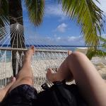 Legs and bodies relaxing in the hammock