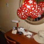 Birthday balloons and cupcakes in room upon arrival